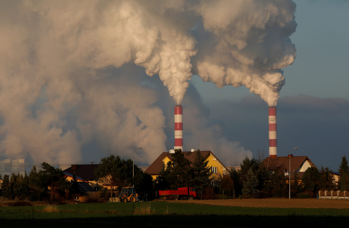 """Smoke and steam billows from Belchatow Power Station, Europe's largest coal-fired power plant near Belchatow, Poland on November 28, 2018. Inventors claim a new carbon capture """"battery"""" could be retrofitted for industrial plants but also for mobile sources of CO2 emissions like cars and airplanes. Photo by REUTERS/Kacper Pempel"""