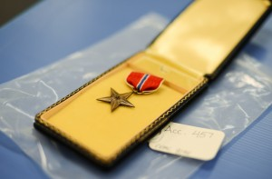 A Bronze Star, the fourth-highest award for bravery, heroism or meritorious service, was collected from the Vietnam memorial and is now housed at the National Park Service Museum Resource Center. Photo by Ariel Min/PBS NewsHour