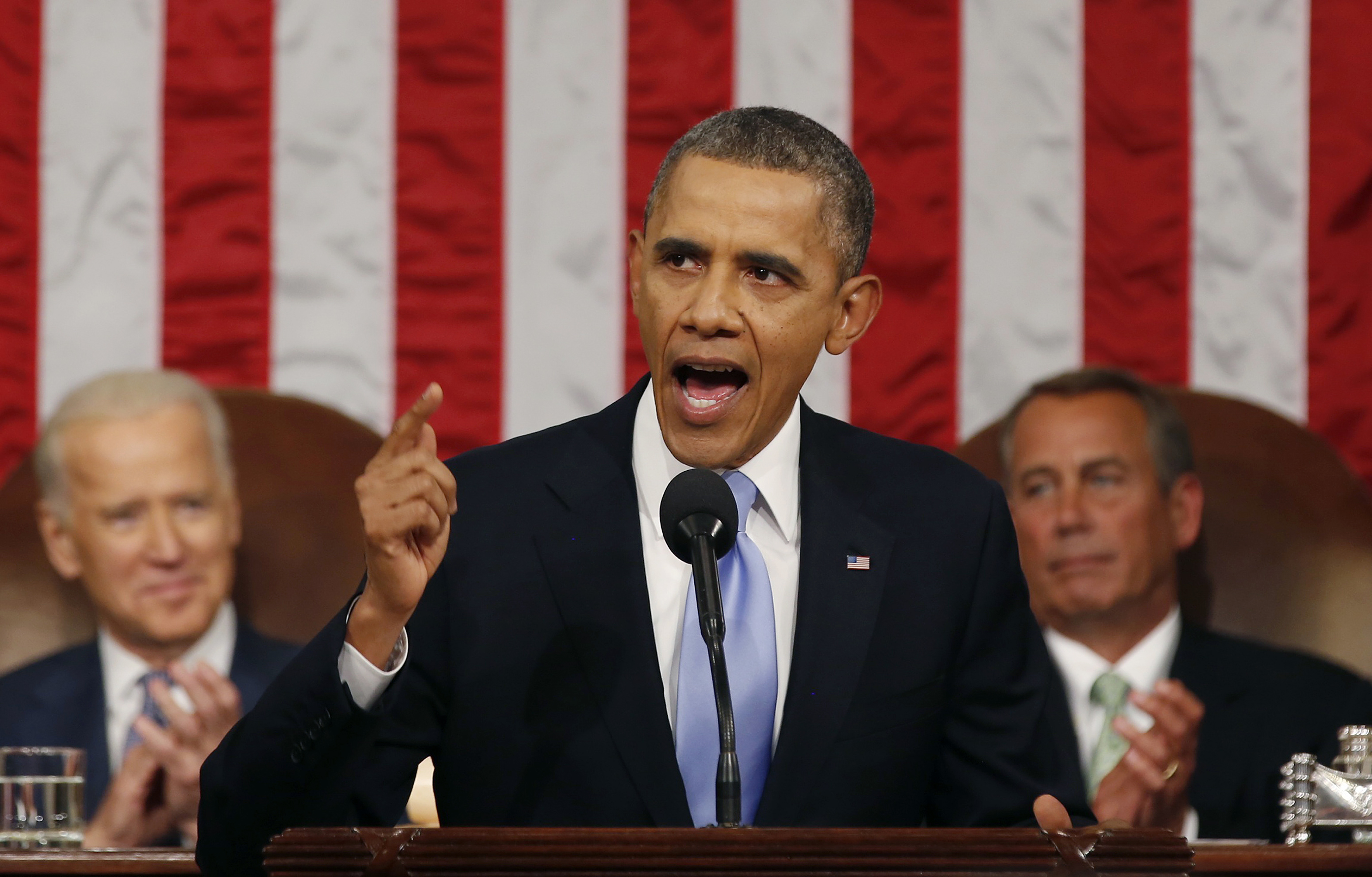 President Barack Obama delivers his State of the Union speech on Capitol Hill on January 28, 2014 in Washington, DC. Photo by Larry Downing-Pool/Getty Images