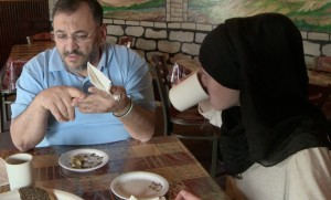 Amal Kassir sits with her father at his Syrian restaurant Damascus Grill, in Littleton, CO.