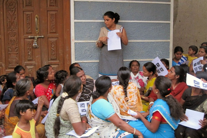 Residents of Bangalore in southern India undergo training to learn how to use InSight, a product that allows people to track their income and expenses by text message. Photo courtesy of InVenture
