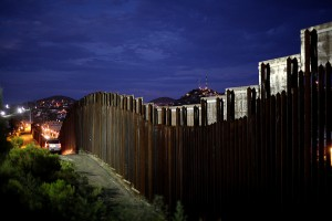 The U.S. border fence between Mexico and Nogales, Ariz. Photo by Sandy Huffaker/Getty Images