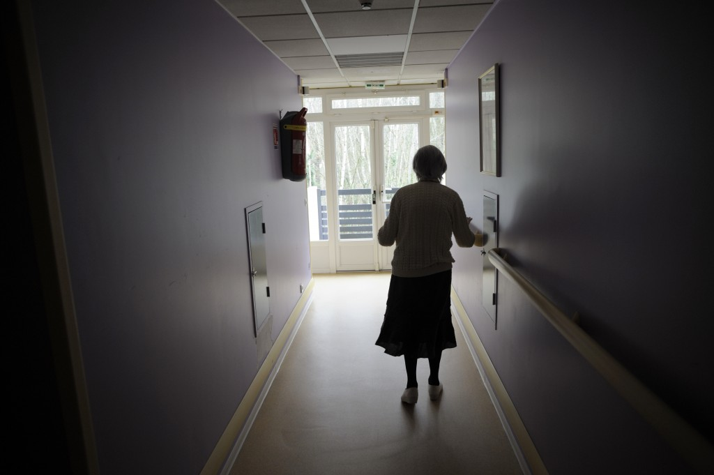 A woman, suffering from Alzheimer's desease, walks in a corridor on March 18, 2011 in a retirement house in Angervilliers, eastern France. AFP PHOTO / SEBASTIEN BOZON (Photo credit should read SEBASTIEN BOZON/AFP/Getty Images)