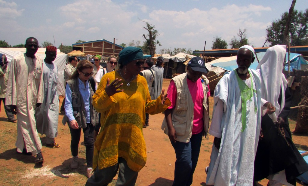 Ertharin Cousin (in yellow), executive director of the U.N. World Food Program, walks with the imam of the Bossangoa mosque (on right) in the Central African Republic on March 19, 2014. Photo by Pacome Pabandji/AFP/Getty Images