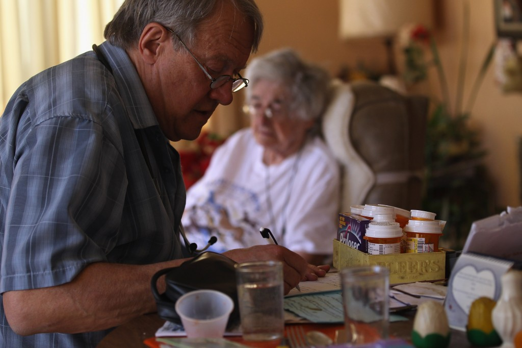Registered nurse Stephen Van Dyke treats a patient while on a home health care visit on March 23, 2012 in Arvada, Colorado. The Supreme Court will hear oral arguments next week on whether the 2010 health law can require most Americans to have health insurance starting in 2014. Van Dyke works for the Dominican Sisters Home Health Agency, a non-profit that performs some 25,000 home visits each year in the Denver area. It provides free home nursing care to patients with chronic diseases, helps them to better manage their disabling illnesses and provides custodial services with the aim of keeping patients in their homes and out of more expensive nursing home care. (Photo by John Moore/Getty Images)