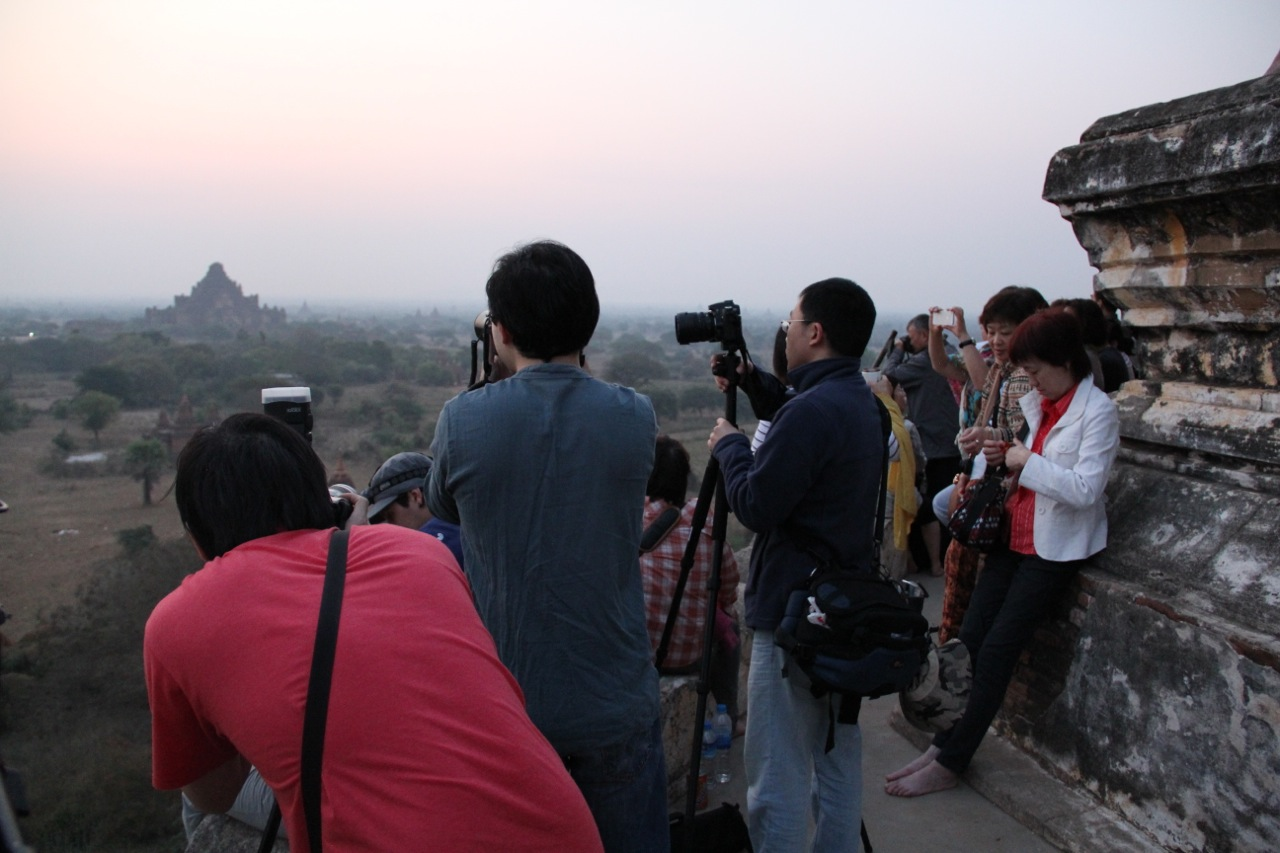 Tourists crowd atop the Shwesandaw pagoda for the first glimpse of dawn in Bagan. Photo by Mary Jo Brooks/PBS NewsHour