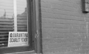 Quarantine sign in window, Dubuque, Iowa Creator(s): Vachon, John, 1914-1975, photographer. 1940 Apr.