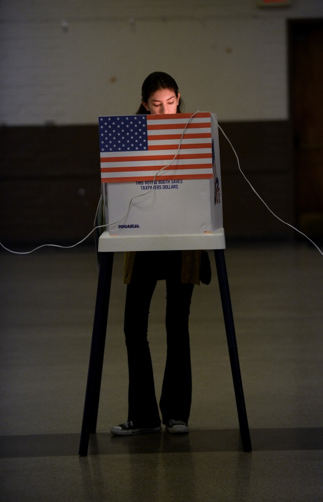 A woman casts her vote for president in Los Angeles in 2012. Photo by Joe Klamar/Getty Images