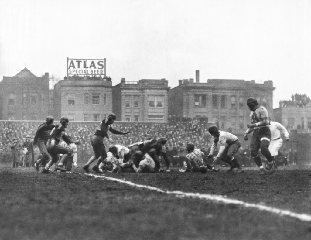 The Chicago Bears recover their quarterback's fumble and go on to win the first scheduled NFL Football Championship game over the New York Giants at Wrigley Field by a score of 23-21 on December 17, 1933. The Chicago Bears played at Wrigley Field between 1921 and 1970. Photo by Underwood Archives/Getty Images)