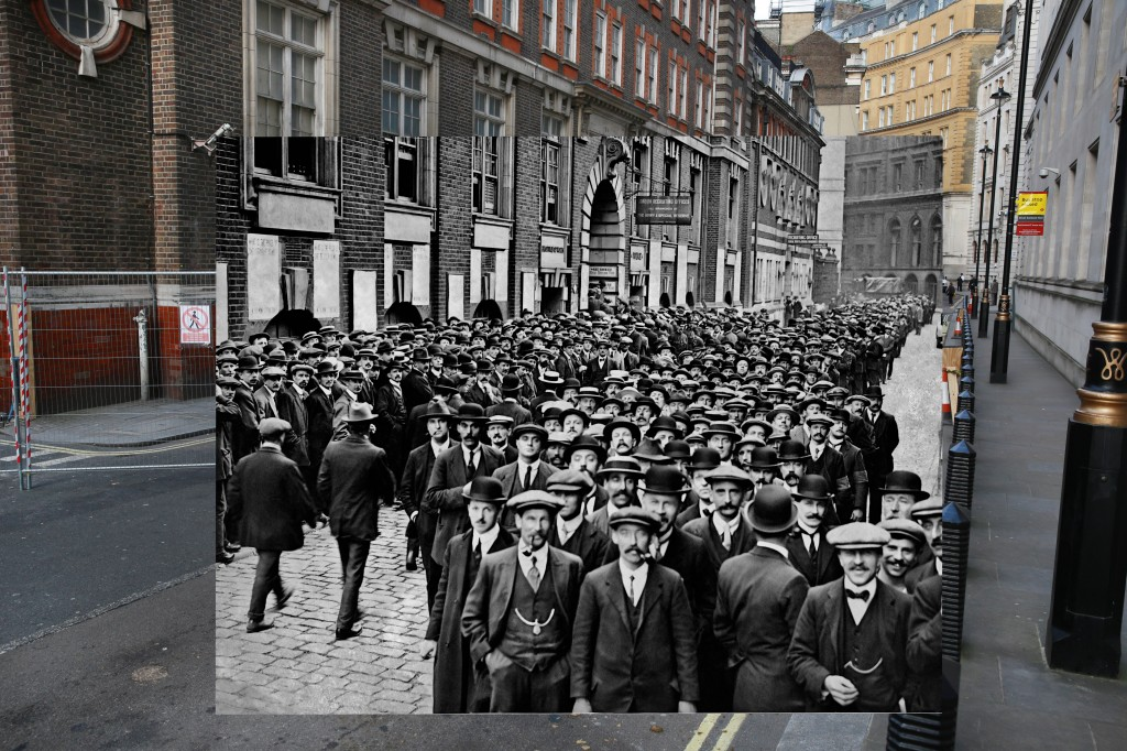 A large crowd of men respond to a call by the War Office for married men aged between 36 and 40 to become munition workers. They gathered outside the Inquiry Office at Scotland Yard in London, England during World War 1. Undated archive photo by Paul Thompson/FPG/Getty Images. 2014 photo by Peter Macdiarmid/Getty Images