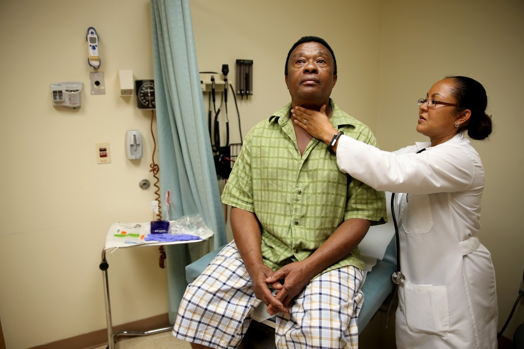 A newly insured patient through the Affordable Care Act receives a checkup April 15 in Hollywood, Florida. Photo by Joe Raedle/Getty Images