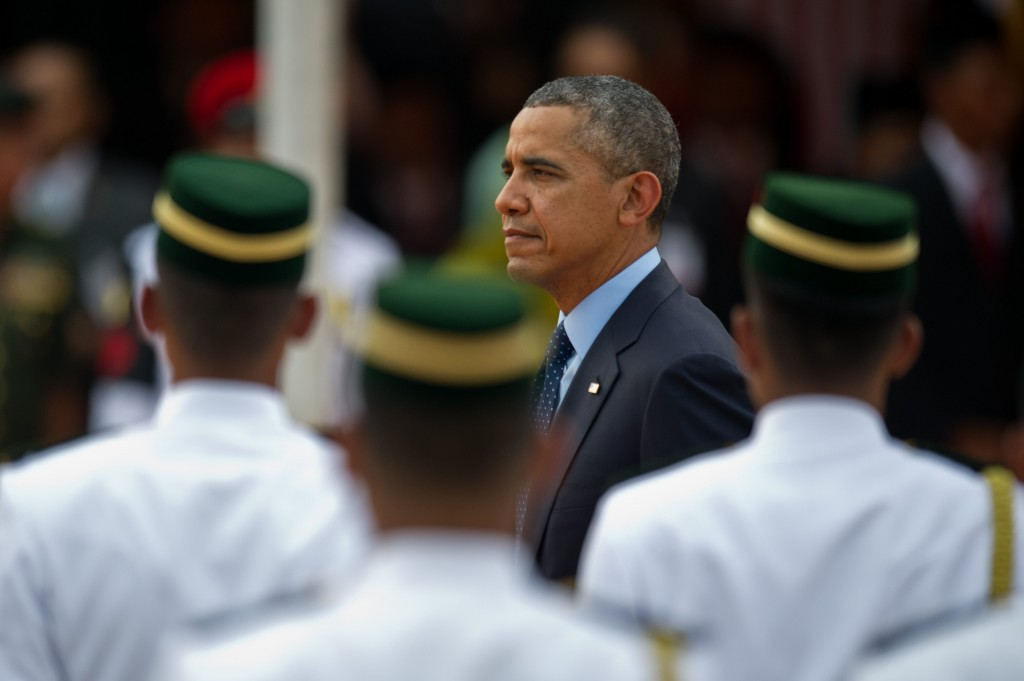 US President Barack Obama (C) inspects the Royal Malay Regiment Guard of Honour during a welcoming ceremony at Parliament in Kuala Lumpur on April 26, 2014.  Obama arrived in Malaysia for a visit aimed at energising relations with the predominantly Muslim nation and re-focusing an Asian tour repeatedly distracted by foreign-policy crises elsewhere.       AFP PHOTO / MOHD RASFAN        (Photo credit should read MOHD RASFAN/AFP/Getty Images)