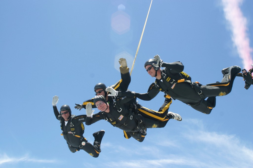 Former President George H.W. Bush (center, bottom) performs a tandem parachute jump with Army Golden Knight Sgt. Bryan Schnell on June 13, 2004 in College Station, Texas, to celebrate his 80th birthday. Photo by U.S. Army/Texas A&M University via Getty Images