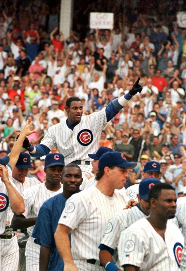 Sammy Sosa is carried off the field on his teammates' shoulders after hitting his 61st and 62nd home runs of the year in a Cubs 11-10 victory over the Milwaukee Brewers 13 September at Wrigley Field in Chicago, IL. Sosa, alongside the St. Louis Cardinal's Mark McGuire, broke Roger Maris's 1961 Major League Baseball home run record. Photo credit should read JOHN ZICH/AFP/Getty Images