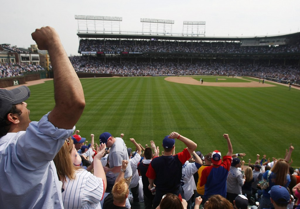 Fans in the left field bleachers of Wrigley Field cheer as the Chicago Cubs score runs in the 4th inning against the New York Mets on April 22, 2008. Photo by Jonathan Daniel/Getty Images