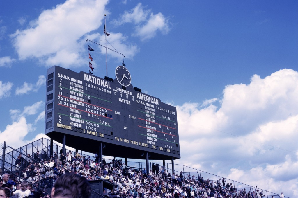 The scoreboard above the centerfield bleachers tells the score of the game as well as those from around the major leagues during a game on May 18, 1963 between the Milwaukee Braves and the Chicago Cubs. Photo by Diamond Images/Getty Images