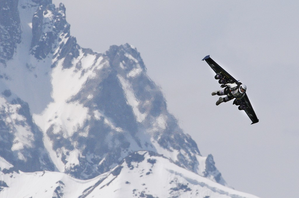 Yves Rossy, known as the 'Fusion Man,' flies with a jet-powered single wing over the Alps in Bex, Switzerland, Wednesday, May 14, 2008. Photo by Anja Niedringhaus/AP