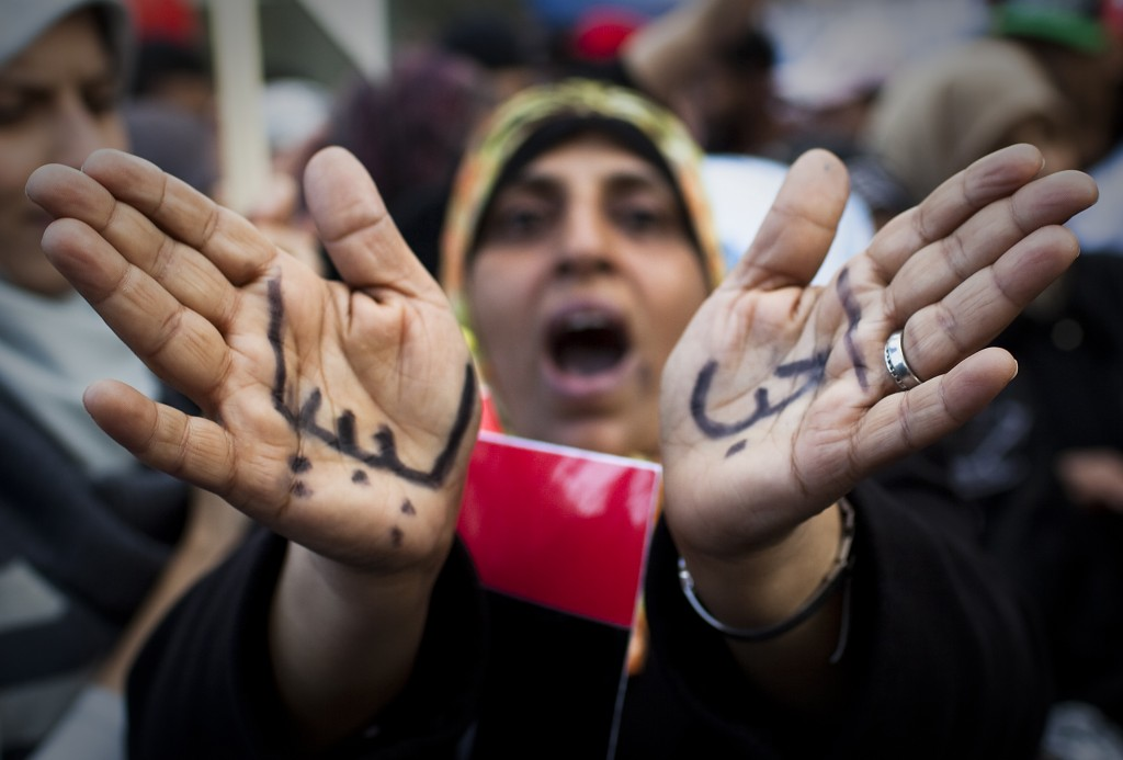 "A Libyan woman reacts with her hands written on them in Arabic "" I love Libya' as she joins a rally in support of the allied air campaigns against the forces of Moammar Gadhafi in Benghazi, eastern Libya, Wednesday, March 23, 2011. Photo by Anja Niedringhaus/AP"
