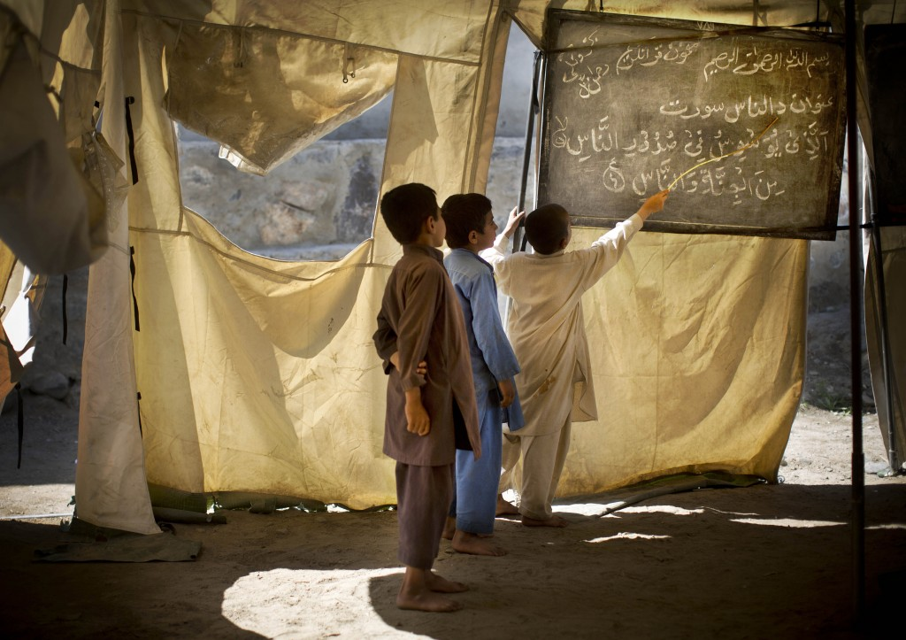Afghan boys study at a makeshift school in the village of Budyali, Nengarhar Province, Afghanistan, Tuesday, March 19, 2013. Photo by Anja Niedringhaus/AP