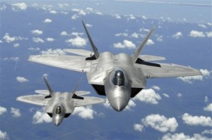 ** FILE ** In this April 2, 2007 file image provided by the US Air Force, two U.S. Air Force F-22 Raptor aircraft flying in trail behind a KC-135R Stratotanker aircraft after inflight refueling during a training mission off the coast of Florida, are shown. Defense Secretary Robert Gates said Monday, April 6, 2009, the Pentagon will end the F-22 fighter jet and presidential helicopter programs run by Lockheed Martin Corp. (AP Photo/US Air Force, Thomas Meneguin, file) **NO SALES**