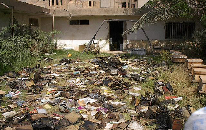Several of the books were laid out in the courtyard in an effort to dry them. Photo courtesy of Harold Rhode