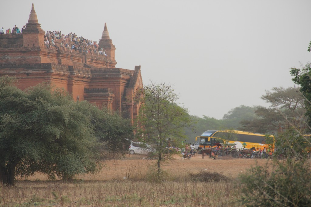 Now that the Myanmar government has launched economic and political reforms, tourists have begun arriving by the busload in Bagan.  A favorite activity -- watching the sun rise or set from atop a pagoda -- has recently been limited to just a few sites. It's part of the government's plan to better preserve the monuments and control crowds. Photo by Mary Jo Brooks/PBS NewsHour