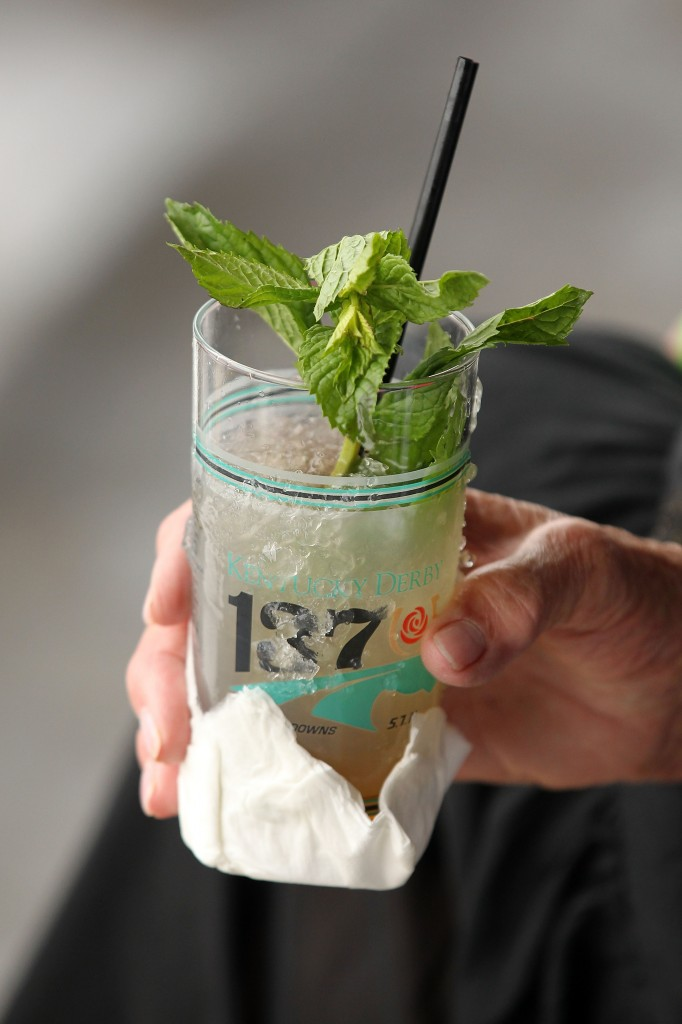 An observer drinks a mint julep during the 137th Kentucky Derby at Churchill Downs on May 7, 2011.  Each year, around 120,000 mint juleps are served at Churchill Downs over a two-day period.(Photo by Al Bello/Getty Images) The mint julep has been promoted by Churchill Downs in association with the Kentucky Derby since 1938. Each year almost 120,000 juleps are served at Churchill Downs over the two-day period of the Kentucky Oaks and the Kentucky Derby, virtually all of them in specially made Kentucky Derby collectible glasses.[7]