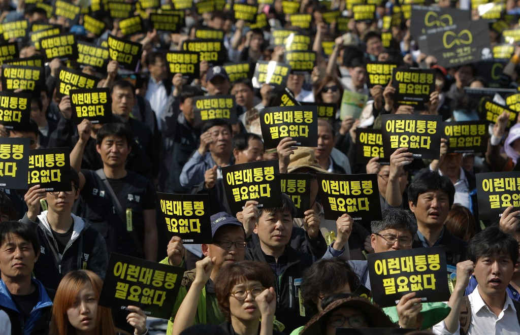 Labor union members hold up placards reading 'We don't need this kind of president' during a May Day rally organized by the Korean Confederation of Trade Unions (KCTU) at the Seoul Railway Station on May 1, 2014 in Seoul, South Korea. Photo by Chung Sung-Jun/Getty Images
