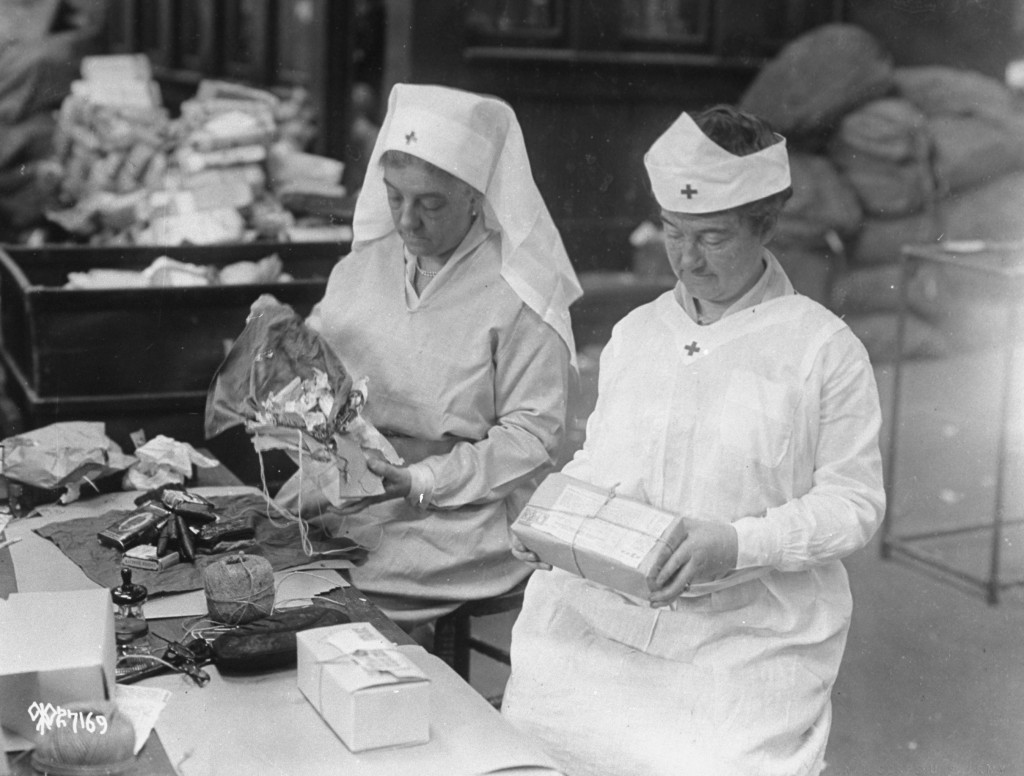In this 1918 photo, American Red Cross women wrap food packages to be sent overseas during WWI. Photo by Time & Life Pictures/Getty Images