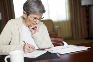 Senior Woman Paying Bills. digitalskillet/iStock 360 via Getty Images. related words: Social Security, Medicare