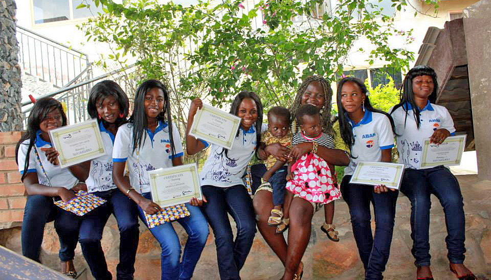 "Members of the graduating class of 2013 pose with their certificates saying they have completed the two-year course in ""sewing, batik, bead making, housekeeping, catering, and business and leadership education."" Mary Serwaa is second from the left and Rebecca Hooper is third from the left. Photo courtesy of ABAN"