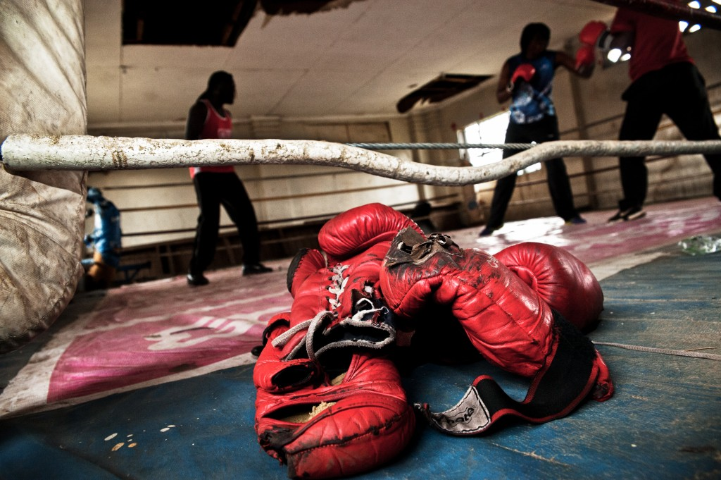 Boxgirls have a match at the Eastleigh Ring in Nairobi. Boxing gloves are very expensive to buy, therefore older ones will be used until they too tattered for another fight. Photo by Mia Collis