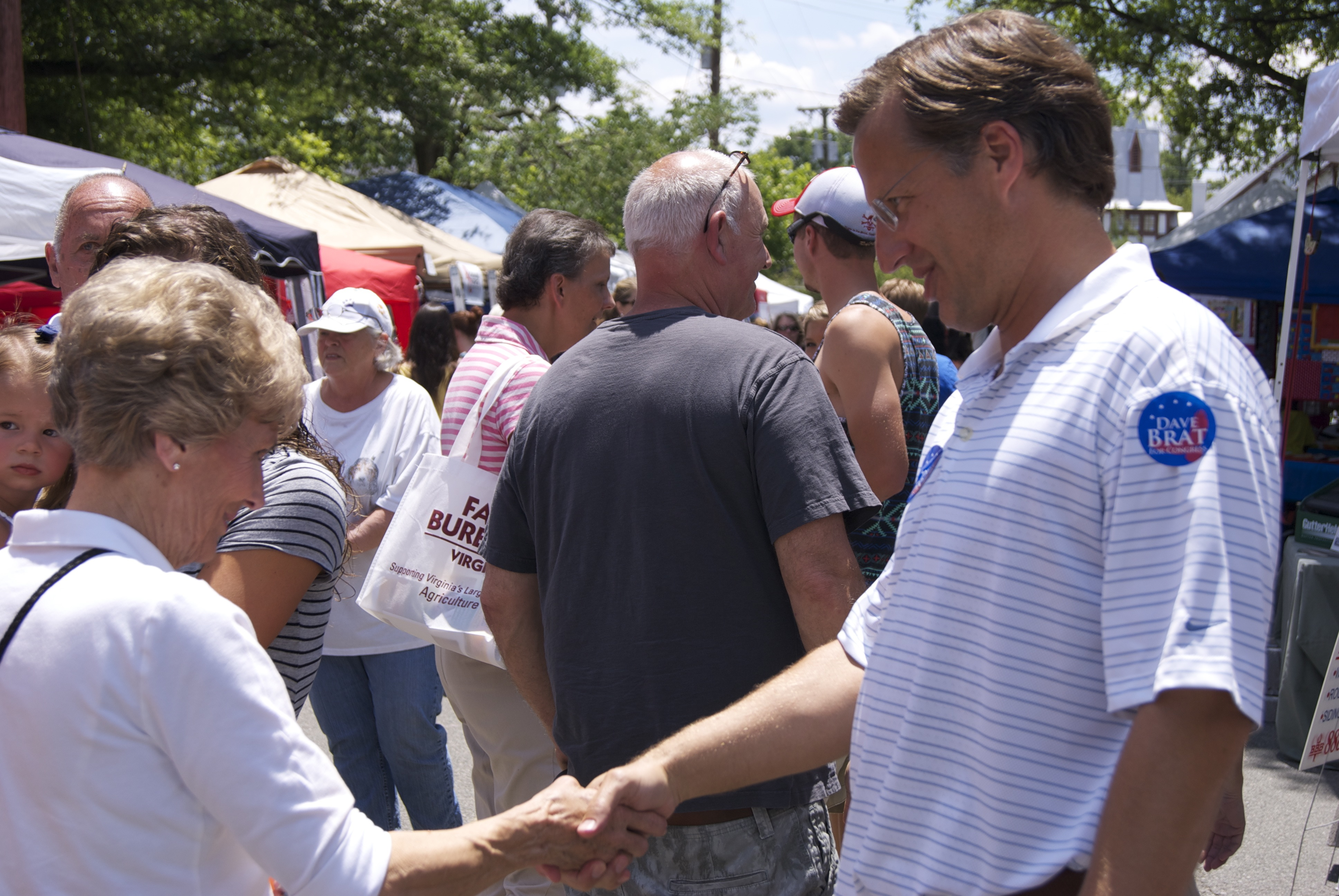 Dave Brat made sure to shake hands with everyone that walked by him at the Ashland Strawberry Faire. Photo by Rachel Wellford.