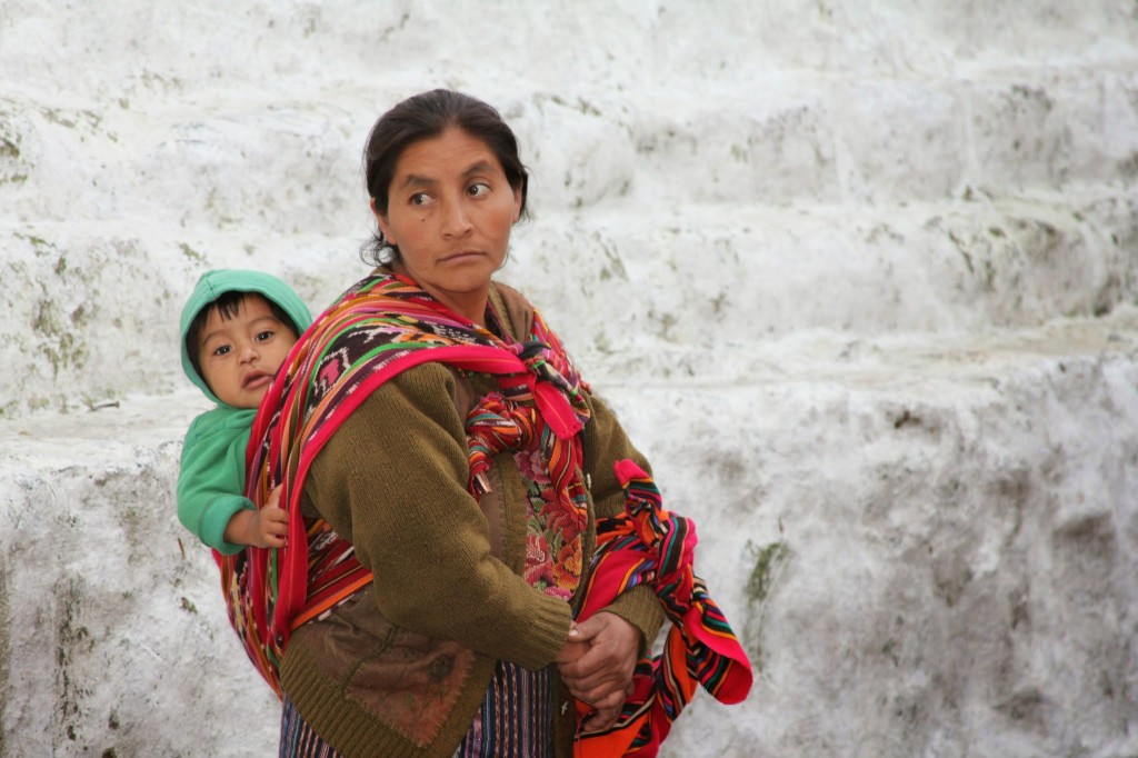 Women in rural guatemala usually carry their babies in a sling made out of cloth called either a rebozos or perraje. Photo by Hari Sreenivasan