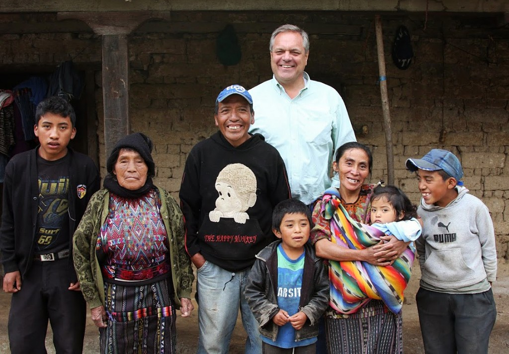 At 6 feet 3 inches, journalist Roger Thurow towers over the Chumil family of Guatemala. Childhood malnutrition can lead to physical stunting. Photo by Hari Sreenivasan