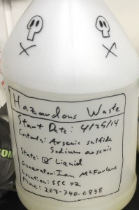 Hand-drawn skull-and-crossbones mark a hazardous waste container used by scientists at a lab at the University of Southern California. Scientists at USC are doing basic research to determine how certain bacteria are able to transfer electrons great distances from themselves to other cells or inorganic minerals. Photograph by Kent Treptow for PBSNewsHour