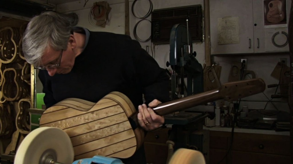 Gary Zimnicki works on a mandolin he made of wood from the floorboards of vacant homes in Detroit. Courtesy DPTV