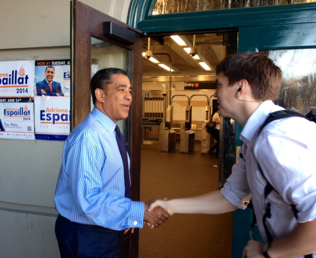 New York State Sen. Adriano Espaillat shaking hands with voters outside the Dyckman Street subway station. Photo by Brigid Bergin/WNYC