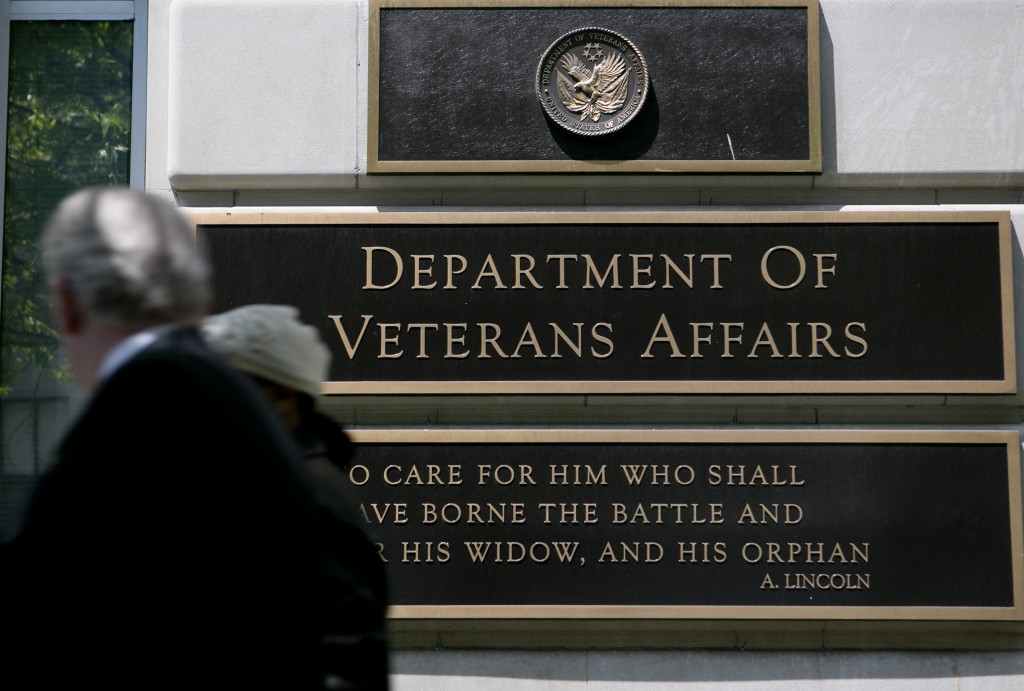 Pedestrians walk past the U.S. Department of Veterans Affairs headquarters in Washington, D.C. Photo by Andrew Harrer/Bloomberg via Getty Images