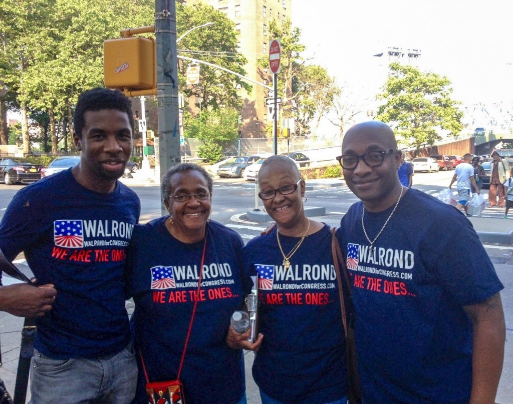 Candidate Michael Walrond, far right, with volunteers in East Harlem. Photo by Brigid Bergin/WNYC