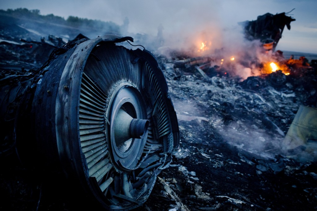 GRABOVO, UKRAINE - JULY 17: Debris from Malaysia Airlines Flight 17 is shown smouldering in a field July 17, 2014 in Grabovo, Ukraine near the Russian border. Flight 17, on its way from Amsterdam to Kuala Lumpur and carrying 295 passengers and crew, is believed to have been shot down by a surface-to-air missile, according to U.S. intelligence officials and Ukrainian authorities quoted in published reports. The area is under control of pro-Russian militias. (Photo by Pierre Crom/Getty Images)