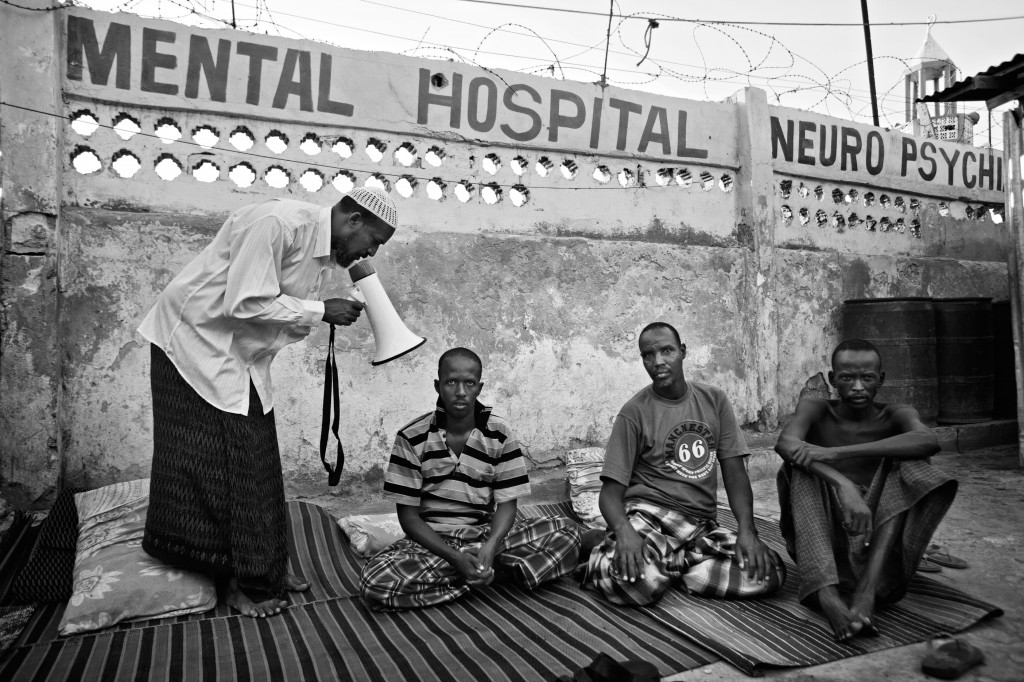 Many Somalis will take their mentally ill relative to traditional or Khoranic healers for treatment. Mogadishu, Somalia. May 2011. Photo Robin Hammond/Panos