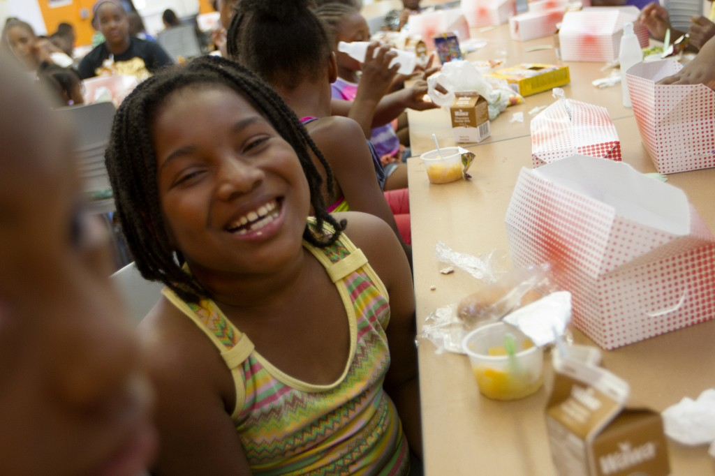Eight-year-old Chalyn Wright attends summer camp at the rec center in D.C. Photo by Margaret Myers/NewsHour