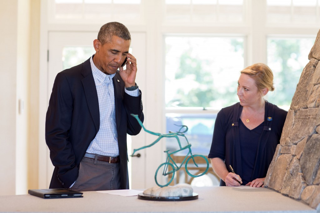 In this photo released by the White House, President Obama speaks on the phone with Missouri Gov. Jay Nixon about the situation in Ferguson, Missouri, in Chilmark, Martha's Vineyard, Massachusetts on August 14, 2014. Photo by Pete Souza