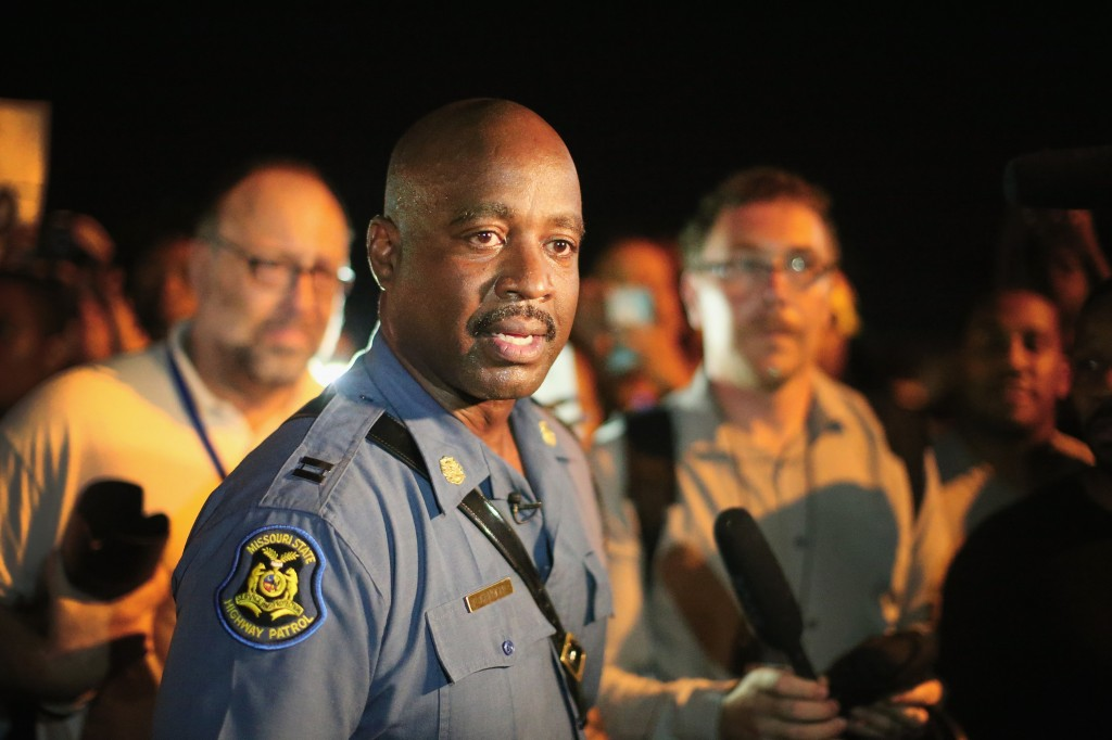 Capt. Ronald Johnson of the Missouri State Highway Patrol, who was appointed by the governor to take control of security operations in the city of Ferguson, walks among demonstrators gathered along West Florissant Avenue on August 14, 2014 in Ferguson, Missouri. Photo by Scott Olson/Getty Images