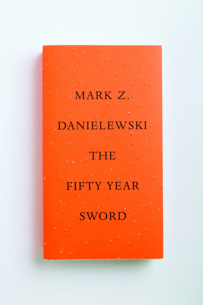 "Each jacket of Mark Z. Danielewski's ""The Fifty Year Sword"" is perforated differently by a special spike axle in China that was created for this design. From Cover by Peter Mendelsund, published by powerHouse Books"