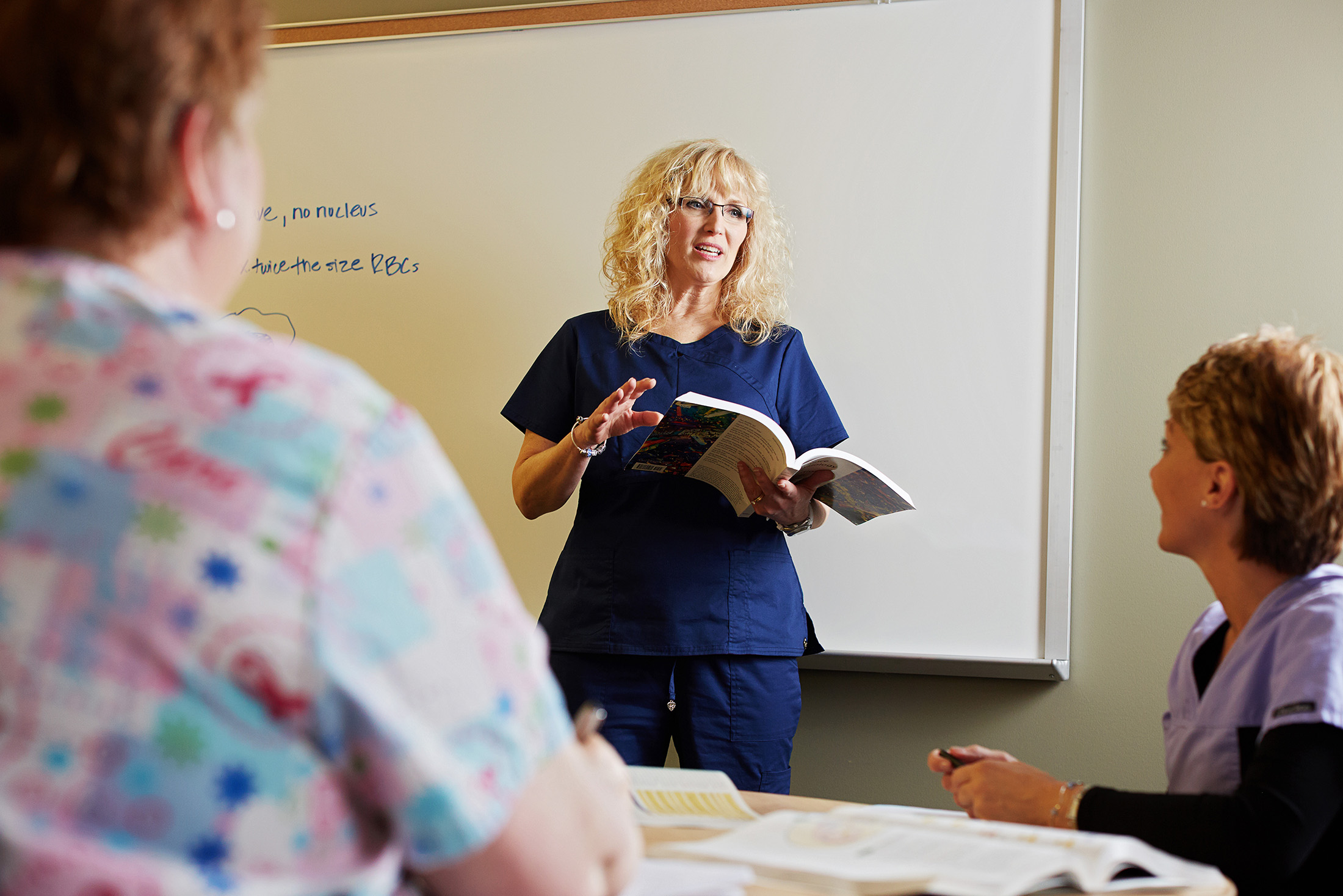 An instructor at Granite State College in Concord, N.H. talks to students in class. If trustees' plans are approved, tuition at the school will go four years without increasing. Courtesy of the University System of New Hampshire.