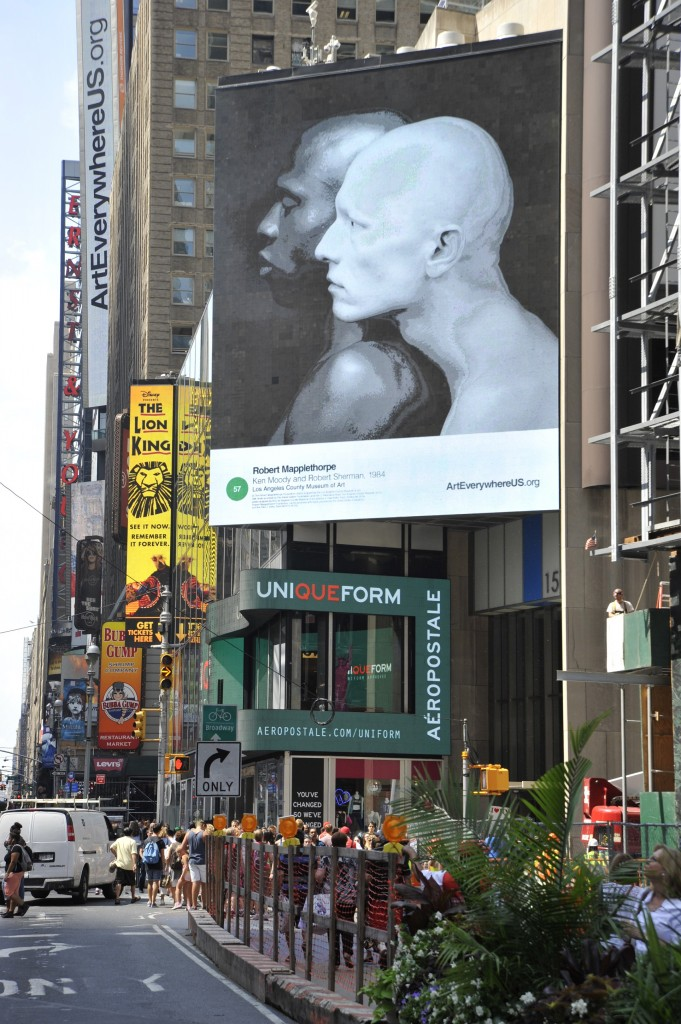 """Art Everywhere US Times Square installation, featuring Robert Mapplethorpe's """"Ken Moody and Robert Sherman"""" (1984, Jointly acquired by the Los Angeles County Museum of Art, with funds provided by The David Geffen Foundation and the J. Paul Getty Trust, © 2014 Robert Mapplethorpe Foundation), photo by Robert Landau."""