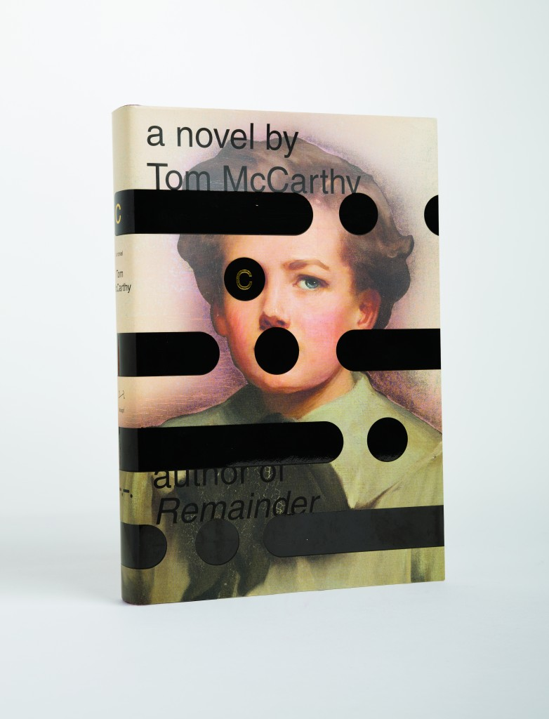 """A boy beset by codes. The symbols over his eye, and the one that appears on, but almost in his mouth, have an aspect of afflication (an eye-patch and a ball-gag) as well as an aspect of adornment."" From Cover by Peter Mendelsund, published by powerHouse Books"
