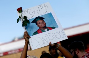 Demonstrators have been gathering in Ferguson, Missouri, since the Aug. 9 shooting death of unarmed teen Michael Brown by a local police officer. Protesters have been gathering nightly to call for the arrest of the officer, Darren Wilson. Photo by Joe Raedle/Getty Images